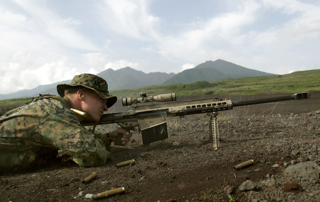 COMBINED ARMS TRAINING CENTER CAMP FUJI, Japan – Corporal Dustin Hill, a scout sniper team leader with sniper platoon, Headquarters and Services Company, 1st Battalion, 5th Marine Regiment, the 31st Marine Expeditionary Unit's Battalion Landing Team, fires a round downrange from an M82A3 .50-caliber special application scoped rifle here Aug. 31. Snipers worked alongside the BLT's combined anti-armor teams conducting various scenarios in sharpening heavy-machine gun and maneuvering skills. (Official United States Marine Corps. photo by Lance Cpl. Kevin M. Knallay)
